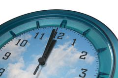 Last second. Wall clock with clouds as face Royalty Free Stock Photography