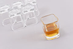 The Last Shot of Whiskey. With Upside Shot Glasses In Background Royalty Free Stock Images