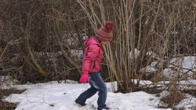 The last snow of the season. Girl child playing snowballs with the last snow. Spring, the snow is almost everywhere melted. Only i stock video