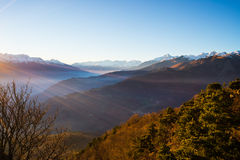 Last soft sunlight over rocky mountain peaks, ridges and valleys of the Alps at sunrise. Extreme terrain landscape at high altitud Royalty Free Stock Image