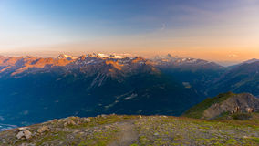 Last soft sunlight over rocky mountain peaks, ridges and valleys of the Alps at sunrise. Extreme terrain landscape at high altitud Royalty Free Stock Photos