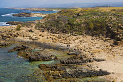 Last stones remaining of ancient city of Biblical Dor. On the beatiful beach of Tel Dor in Israel Stock Image