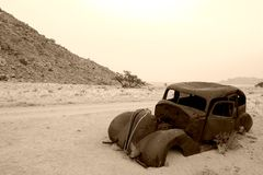 The last stop. Old car in the Namibian desert's last stop Royalty Free Stock Photos