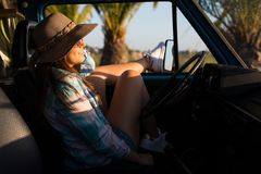 At Last! Summer Holidays!. Summer holidays, road trip, travel and people concept, young woman resting in minivan car stock photos