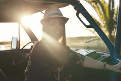 At Last! Summer Holidays!. Summer holidays, road trip, travel and people concept, young woman resting in minivan car stock photo