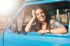 At Last! Summer Holidays!. Summer holidays, road trip, travel and people concept, young woman resting in minivan car stock image