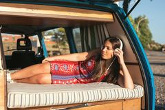 At Last! Summer Holidays!. Summer holidays, road trip, travel and people concept, young woman resting in minivan car royalty free stock photography