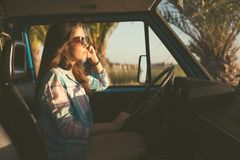 At Last! Summer Holidays!. Summer holidays, road trip, travel and people concept, young woman resting in minivan car royalty free stock photo