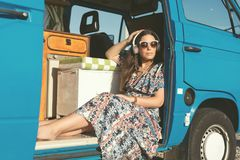 At Last! Summer Holidays!. Summer holidays, road trip, travel and people concept, young woman resting in minivan car royalty free stock image
