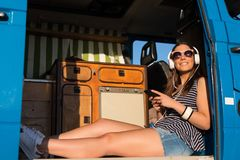 At Last! Summer Holidays!. Summer holidays, road trip, travel and people concept, young woman resting in minivan car stock images