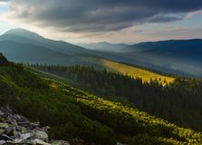 Summer Carpathian mountain, Ukraine. Last sun rays in evening sky with clouds above Syniak mountain. Summer sunset view from Homiak mountain, Gorgany, Carpathian Stock Photo