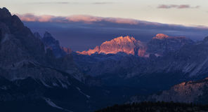 Last sun rays. Touch the top of the mountain, Dolomites, Italy. View from Passo Giau Stock Image