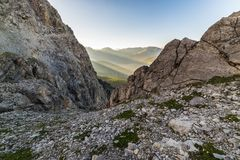 Last sunbeams on alpine valley Royalty Free Stock Photos