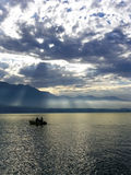 Last sunrays. Boat on the Thunersee - lake in Switzerland - in the last sunrays just before sunset. Colors not edited Royalty Free Stock Images