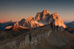 Last sunrays touch the mountain peak Royalty Free Stock Photos