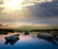 Last sunrise and fishing Royalty Free Stock Images
