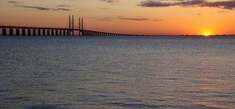 Last sunshine near the bridge Stock Images