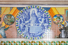 Last Supper. Crypt tiles showing Bible and St Benedict life. Royalty Free Stock Photos