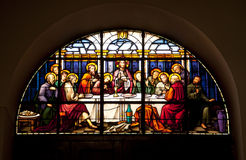 The Last Supper Glowing in the dark. A stained glass window in Gibraltar showing the last supper Royalty Free Stock Photo