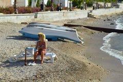 The last tourist on the beach Stock Photo