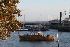 Last trips to the sea. Still boats at sunny harbor in Helsinki Royalty Free Stock Photos