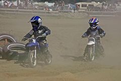 The last two. These two kids 7-10 were at the tail end of the moto cross race at massey ontario Royalty Free Stock Photo