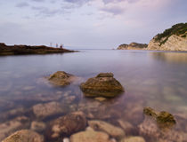 Last Visitors of the Day. Beautiful mediterranean cove located in the Costa Blanca of Spain Royalty Free Stock Photography