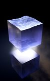 The last water cube. Because our world water supplies are smaller every day maybe this is our future of storing water. Blue water cube with reflection on the stock photography