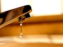 Last water drop from tap Stock Photos