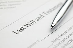 Last Will. A blank last will and testament form with a pen laying over it stock image