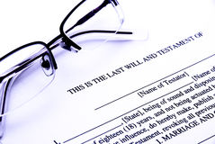 Last will. Photo of a Last Will and Testament document with glasses - blue style stock photography