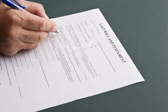 Last will and testament. Man filling out his last will and testament stock image