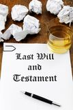 Last Will and Testament. And glass of whiskey on a wooden desk royalty free stock image