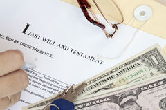 Last Will and Testament. With dollars and hand ready for fill-up the form stock image