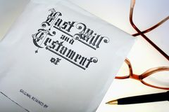 Last Will & Testament. Last will and testament document with eyeglasses and pen