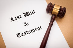 Last Will and Testament. A gavel on top of a Last Will and Testament contract, with a antique-like background stock photos