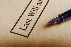 Last Will and Testament. Close up of the bordered title of a last Will and Testament set on parchment paper with nib of fountain pen to the right royalty free stock images