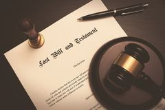 Last Will and Testament concept. Fountain pen, gavel on desk stock images