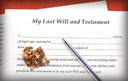 Last Will and Testament form with gold jewelry on red background Royalty Free Stock Image