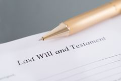 Last will and testament. And golden pen. Closeup shot royalty free stock images