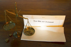 Last Will and Testament with Legal Scales. Last will and testament document with legal scales on wooden desk stock photo
