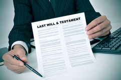 Last will and testament. Man in suit showing where the testator must sign in a last will and testament document Stock Image
