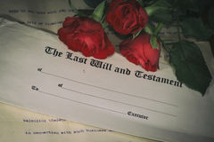 Last will and testament. With red roses background stock photo