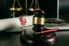 Last will and testament with wooden judge gavel document is royalty free stock photos