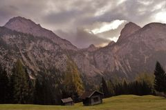 Huts and mountains. Last year I brought my hiking buddies for a day trip on Wetterstein Alps. Here a view of the Wetterstein mountains and huts in the valleys Stock Photography