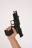 lastad av pistol Arkivfoton