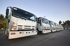 Lastbilar i en rad Arkivfoto