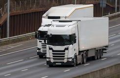 Lastbilar i rörelse Royaltyfria Foton