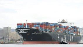 Lastfartyg HANJIN FÖRENADE KUNGARIKET som avgår porten av Oakland Royaltyfria Foton