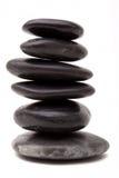 Lastone therapy rocks. Stack of lastone therapy rocks on white background Stock Photo